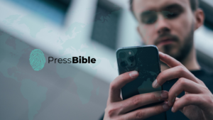 Man on iPhone with the PressBible App